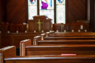 Church Pews with Stained Glass Beyond Pulpit