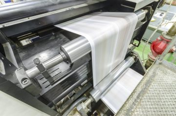 Large webset offset printing press running a long roll paper
